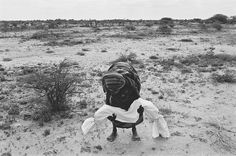 1992 A mother carries her dead child to the grave, after wrapping it in a shroud according to local custom. A bad drought coupled with the effects of civil war caused a terrible famine in Somalia which claimed the lives of between one and two million people over a period of two years, more than 200 a day in the worst affected areas. The international airlift of relief supplies which started in July was hampered by heavily armed gangs of clansmen who looted food storage centers and slowed…
