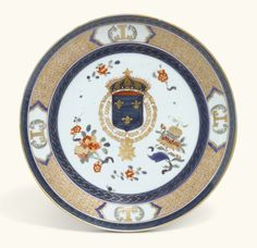 A French Armorial porcelain plate, probably Samson late 19th century painted at the centre with the French Royals arms bearing the fleurs-de-lys, against a ground scattered with branches and sprigs of fruit and flowers, inside a gilt-scroll border reserved with four panels enclosing LL monograms