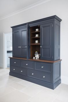 not blue colour but like cabinet style with wood feature & plinth at top