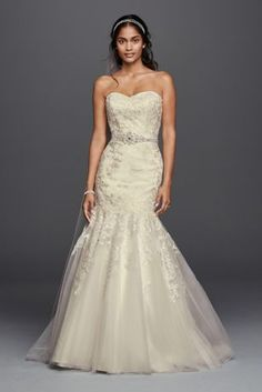 Allover beaded lace imbues this mermaid wedding dress with a romantic, vintage feel. The tulle skirt creates a dramatic yet airy hourglass shape.  Jewel, exclusively at David\'s Bridal.  Belt sold sep