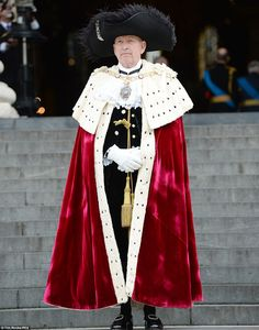 Standing guard: The Lord Mayor of London, dressed in full regalia, stands outside St Paul's as he awaits the arrival of the Royal Family
