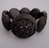 """VICTORIAN bog oak carved shamrocks bracelet, 7"""" by 1"""" to 2-1/4"""" wide. Looks rather like a bracelet of Oreos."""
