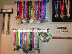 Medal display.  Simple curtain rods from Walmart.  Much less expensive that medal holders.  www.goobermonkey.com