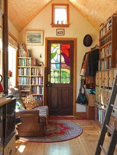 When you go inside, you'll find a book lover's dream, with an entire wall of built-in shelves overflowing with books and another bookcase near the couch with even more books.