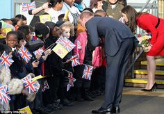 The royal couple bent down to make sure they could speak to the young well-wishers...