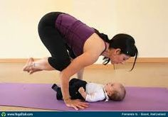 A girl doing a yoga poses in front of baby.