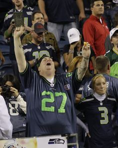 Seattle Seahawks fan grates cheese during the team's controversial win over the Packers last night.