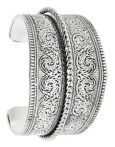 An ornate scrolling design and antiqued finish lend heirloom-quality style to a silvery cuff that pairs perfectly with boho ensembles.