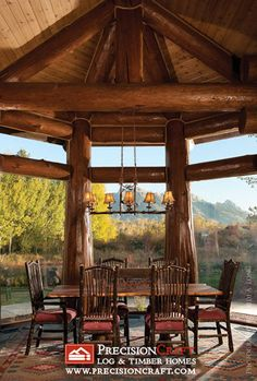 Handcrafted Log Home Dining Room by PrecisionCraft Log Homes & Timber Frame.