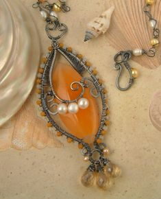 http://www.artfire.com/ext/shop/product_view/fleurviolettejewelry/2277248/orange_jade_agate__quartz__pearls__honey___white_jade__silver_necklace/handmade/jewelry/necklaces/wire_wrapped 134.97