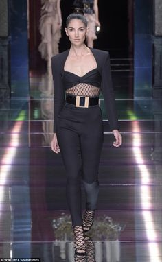 Stunning display: She looked flawless in high-waisted trousers and a mesh cut-out bralet...