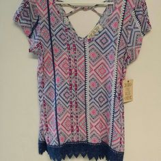 Top Nice summer top,  with an awesome pattern. V-neck front&back with a criss/cross in the back. Gorgeous jagged crochet trim.   100%Rayon....Brand new     Pink Rose Tops Tank Tops