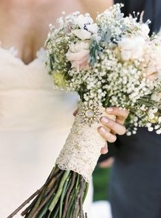 This bouquet combines two trends we are seeing with our Brides adding a memento and baby's breath flowers.