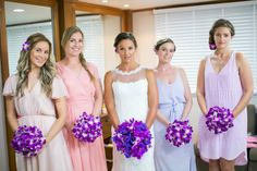 Who said bridesmaid dresses had to match? Jocelyn's bridesmaids look stunning in shades of pastal purple and pink. Faraway Beach weddings Thailand