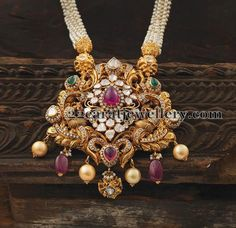 Multi string pearls mala with antique nakshi peacock pendant studded with polki diamonds, rubies and emeralds. India Jewelry, Temple Jewellery, Pendant Jewelry, Beaded Jewelry, Gold Jewelry, Pearl Pendant, Gold Pendent, Pendant Earrings, Gold Bangles