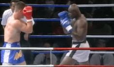 Ernesto Hoost kickboxing and finishing his combination with a low kick.