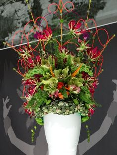 Gloriosa Lily Cymbidium orchid, celosia in lime green displayed at RHS Chelsea lovely for a summer Party