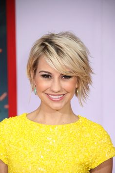 Mussy Bob by Chelsea Kane-The Bob With Bangs – A blunt cut bob just above the jawline can look super trendy with a variety of fringes. To highlight the eyes go for a heavy front fringe. For a softer look try a side swept fringe, or better still ask your stylist to give you the fringe that they think will work best for you. A little trust in your stylist can often give you a gorgeous look that you would never have dreamed would suit you!