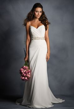 Brides: Alfred Angelo. Chiffon overlay gown with a fully draped sweetheart bodice, beaded spaghetti straps and inverted Basque dropped waistline. Natural waist with crystal beading, rhinestones and sequins. Narrow A-line skirt asymmetrically draped and finishes in a chapel length train.  Available with zipper back closure as Style 2494Z.