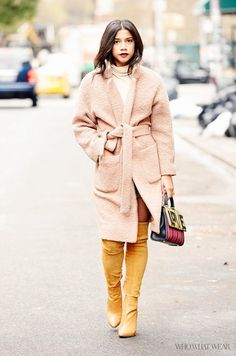 Hannah Bronfman wears a Ganni coat with a turtleneck, a suede skirt and over-the-knee boots.
