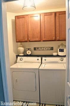 Laundry Room Re-do. Putting a shelf over the washer and dryer for extra space & decor. Adding a DIY painted rug, Antique scale, painted sign, DIY wire basket light fixture, & DIY laundry Soap.