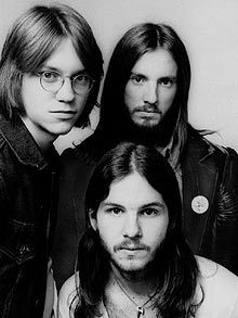 Dan Peek (bottom), 1/3 of the 70s group America, was born today 11-1-1950 - upper l-r -  Gerry Beckley and Dewey Bunnell - America around 1972