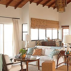 bamboo blinds extend beyond the top of the actual window. Hung higher, it gives the illusion of a taller, more expansive space.""