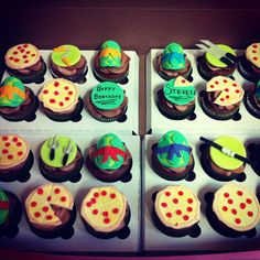Teenage Mutant Ninja Turtles cupcake toppers made of fondant. Includes turtle shells, weapons, and of course, pizza. :)