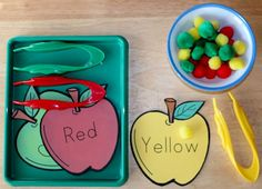 Apple color pom pom sorting tray activity for preschoolers! A fun fine motor activity that promotes color recognition
