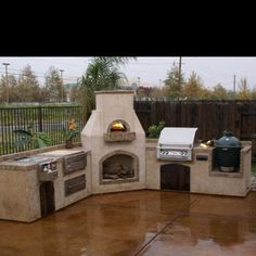 Outdoor kitchen w/ a wood burning pizza oven