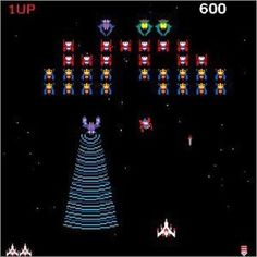 Space Invaders...very late 70's or was it 1980???... also a song by Player One.... but I've just realised this game is Galaga...