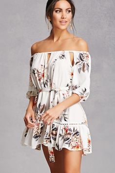 A woven dress featuring an allover floral print, an elasticized off-the-shoulder neckline, a ruffle hem, sheer lattice trim, keyhole chest cutout, self-tie waist, and 3/4 length sleeves with shoulder cutouts and elasticized cuffs.<p>- This is an independent brand and not a Forever 21 branded item.</p>