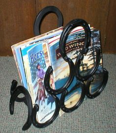 Google Image Result for http://wfrontiersales.com/crafts/craft_pictures/ST_3_Bottle_Magazine_Rack_1.JPG #Horseshoecrafts
