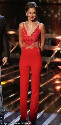 Super toned: The fitted jumpsuit showed off Cheryl's tiny frame, while Mel flashed a little leg