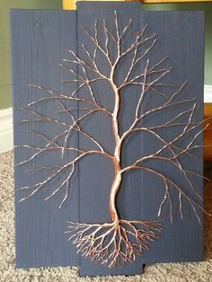 Hey, I found this really awesome Etsy listing. Copper wire tree. Wire art, home dacor at https://www.etsy.com/listing/291290561/copper-wire-tree-on-dark-blue-home-decor