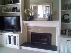 fireplace with built in bookshelves | ... Custom Trimwork and Painting - Fireplace Mantels & Built-in Cabinets