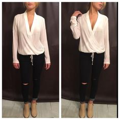 Ivory Tied Wrapped Long Sleeve Blouse This is absolutely stunning with amazing quality! This blouse is perfect for a night out or to wear to work with your favorite blazer! 100% Polyester & fully adjustable front tie! Available in S M L Boutique Tops Blouses