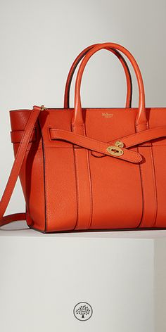The Zipped Bayswater bag is the perfect option for those who like a zipped closure. Using the same construction as a Bayswater, this new style plays with the detail – deconstructing the front by removing the flap and using the iconic postman's lock to secure two belted straps. Shop this Orange Zipped Bayswater in Small Classic Grain Leather at Mulberry.com.