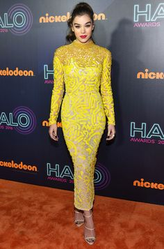 Hailee Steinfeld attended the Nickelodeon Halo Awards in New York wearing a breathtaking J. Mendel beaded yellow dress and Giuseppe Zanotti nude heels. She chose to accessorize with punk black nail polish on her hands and feet.
