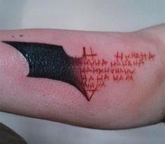 Batman/Joker tattoo.