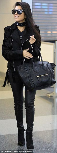 Lady in black: Kourtney kept it simple in an all-black ensemble...