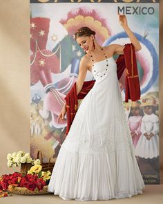 Wedding Dress Inspired by Oaxaca, Mexico    The full skirt of this floor-sweeping chiffon dress is adorned with appliques and fluffed up with a crinoline for a Flamenco-style swoosh.
