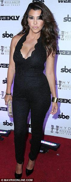 Kourtney kardashian black lace jumpsuit with plunging neckline