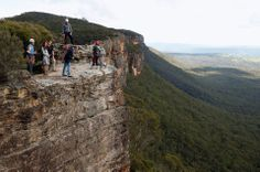 Prince William stands on the edge of a cliff as he and Kate Middleton visit the Narrow Neck Lookout and observe abseiling by the Mountain Youth Services group in the Blue Mountains town of Katoomba, west of Sydney