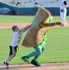 Kids try to tackle The Puffy Taco, the Missions' mascot