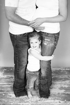 Love the child as the main focus with the parents from waist (bump) down