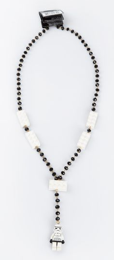 Unique necklace with combination of black and white beads, white Lego blocks and Storm Trooper Lego as a main detail in this necklace.  http://www.zocko.com/z/JJjU9