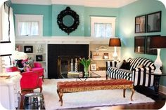 I don't know what room this would be good in, but I love the aqua, black and white - especially the striped couch.