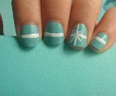 I like the Tiffany idea.  Could probably do without the straight lines and stick with just the bow.