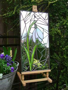 Mosaic garden mirror (31 x 62cm / 1' x 2'), handmade using stained glass and recycled mirror.